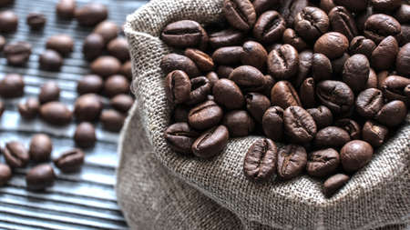 Coffee beans close-up. Coffee in a canvas bag for festive decoration. In anticipation of a fragrant drink