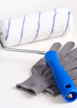 Paint roller, protective gloves, everything for repair and painting.