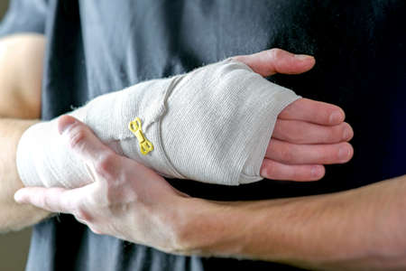 Sports injury of the hand. Primary care, the hand is tightly fixed with an elastic bandage.