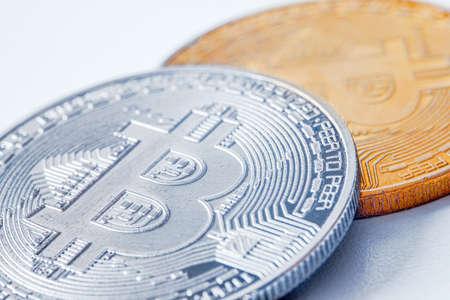 Golden coins with bitcoin symbol on a mainboard. Banco de Imagens