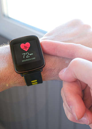 Smart technologies. A person adjusts the settings of a sports watch for outdoor training