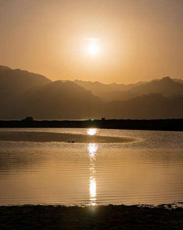 dahab: Sunset over mountains and lagoon in south Sinai, Dahab, Egypt Stock Photo