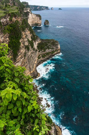 nusa: Rocky cliff and sea waves, Nusa Penida, Indonesia Stock Photo