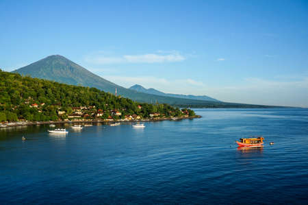 bali: Scenic lagoon with boats in small village Amed on the East of Bali