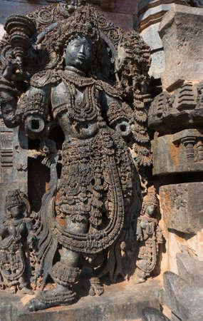 karnataka culture: HALEBID, INDIA - 06 DECEMBER 2014. Image of goddess in Hoysaleshwara Hindu temple , Halebid, Karnataka, India Editorial