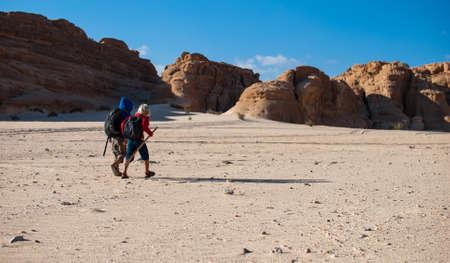 wayfarer: Two boys walking in the desert to canyon, Sinai, Egypt