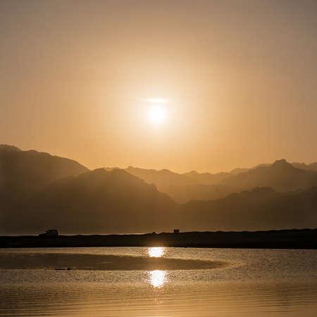 sinai: Sunset over mountains and lagoon in south Sinai, Dahab, Egypt Stock Photo