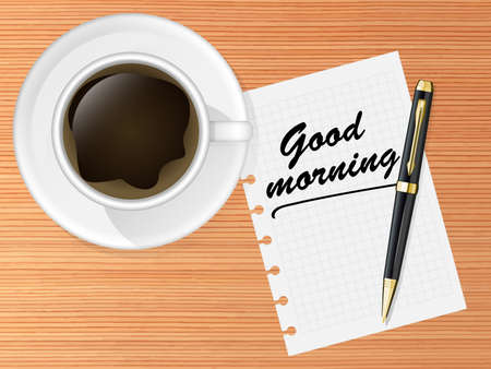 luncheon: Coffee cup on a table with pen and Good morning message