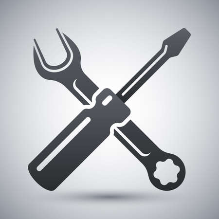 Simple icon of a screwdriver and a wrench on a light gray background. Hand tools for repair and construction