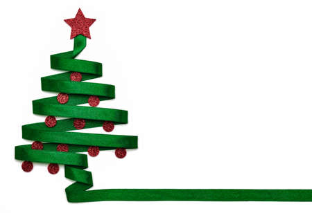 Stylized Christmas tree made from green ribbon with red shiny star and Christmas balls on white background