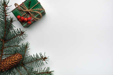 Christmas or New Years composition with a gift box, Fir branches and cone on a white background. Copy space, flat lay, view from above Stockfoto