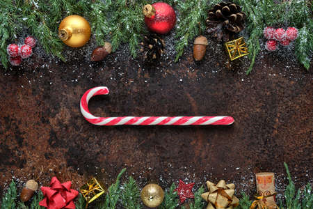 Christmas or New Year loading concept. Stylized loading progress bar from candy cane on a dark stone background. Flat lay, view from above