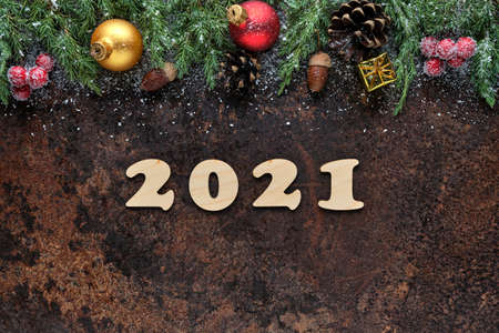 Happy New Year festive background with wooden numbers 2021 and Christmas decorations on stone surface. Flat lay, view from above