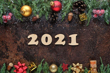 New Years Eve festive background with wooden numbers 2021 and Christmas decorations on stone surface. Flat lay, view from above 版權商用圖片