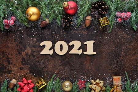 Christmas or New Years Eve festive background with wooden numbers 2021 and Christmas decorations on stone surface. Flat lay, view from above 版權商用圖片
