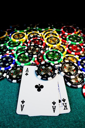 Big slick, Ace-King, surrounded by poker chips