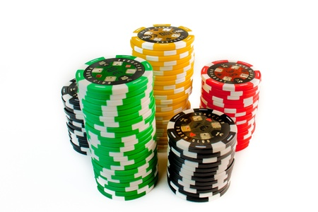 casinos: colorful stack of gambling chips on white background
