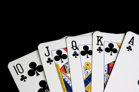 detail of a royal flush on black background photo