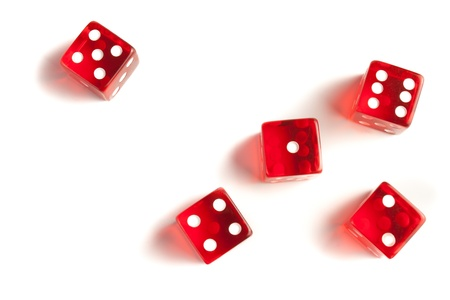 five red dice view from above on white background