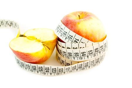 quimica organica: detalle de una manzana con una cinta m�trica Foto de archivo
