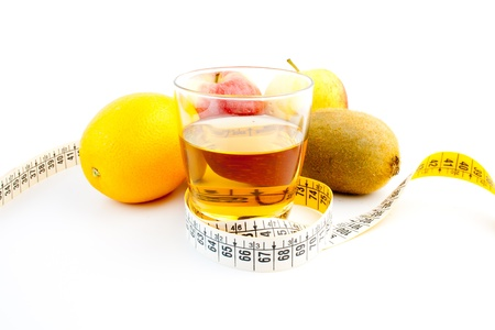 detail of glass and fruit  with measuring tape Stock Photo