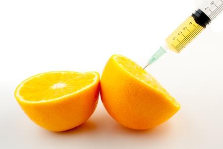 detalj av en injektion och en apelsin Stockfoto