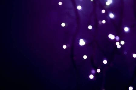 white defocused lights on abstract  violet background