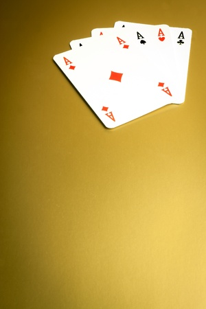 detail of  poker hand on gold background Stock Photo