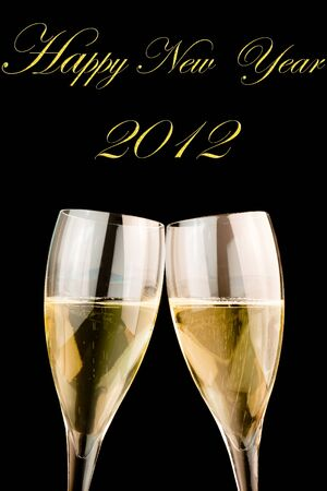 detail of glasses of champagne on balck background with space for text photo