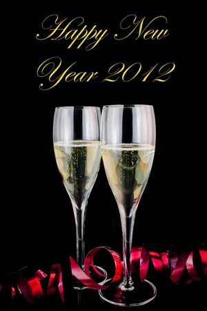 detail of glasses of champagne with red decoration on black background with space for text