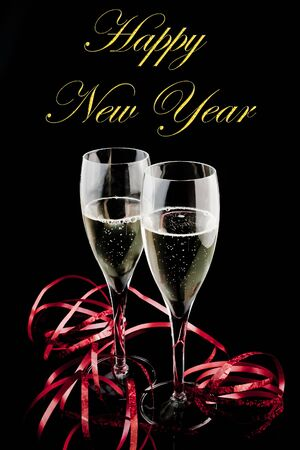 detail of two glasses of champagne decorated on black background with space for text photo