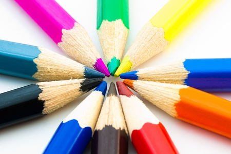 close up of many colorful pencils arranged in circle photo