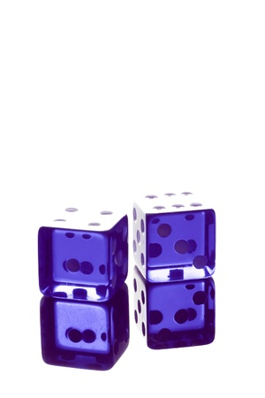 blue dice shot with high-key lighting on transparent table photo