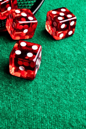 detail of red dice in corner in of a green table Stock Photo - 11585936