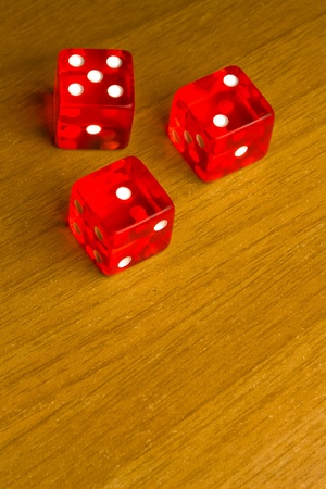 detail of red dice on old wood desk Stock Photo - 11586167