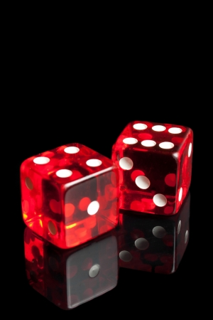 detail of red dice on transparent black background