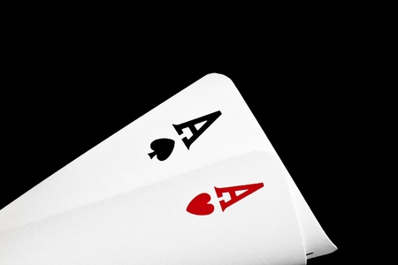 detail of a pair of winning aces  on black background photo