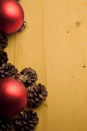 cone and christmas decoration on wood with space for text photo