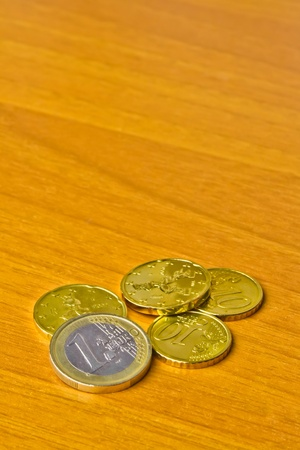 detail of euro coin on wood table photo