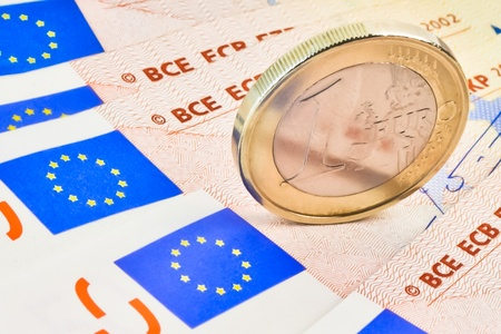 european economic community: detail of euro coin on 50-euro banknotes Stock Photo