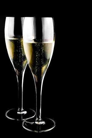two glass with champagne on a black background photo