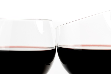 two glasses of wine make cheers on white background photo
