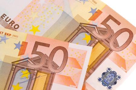 european economic community: detail of  50-euro banknotes on white background