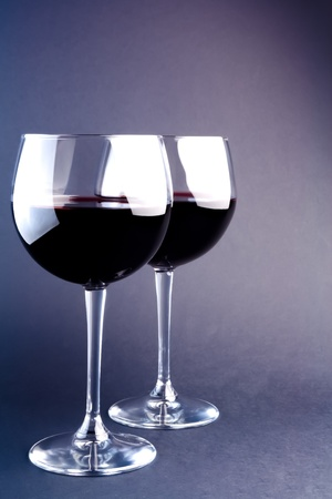 glasses of wine on a light purple background photo