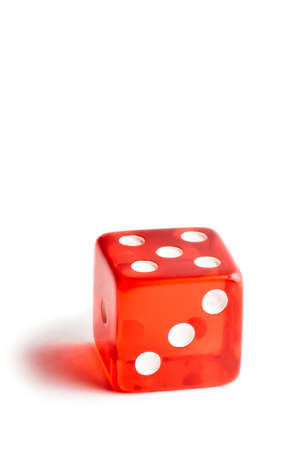 close up of a red dice on white background with space for text photo