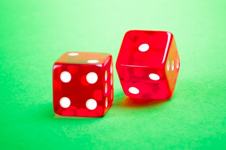 two red dices on green background  photo