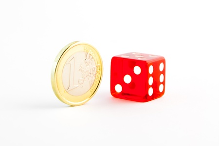 one euro coin and one red dice on white background photo