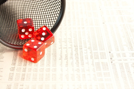 detail of three red dice on the financial newspaper photo