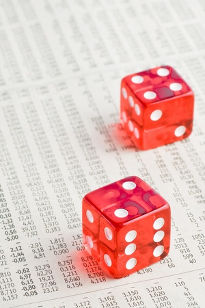 detail of two red dice on the financial newspaper photo