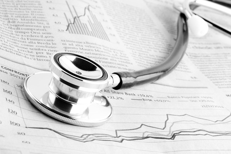 bank crisis: detail of a stethoscope on financial chart Stock Photo